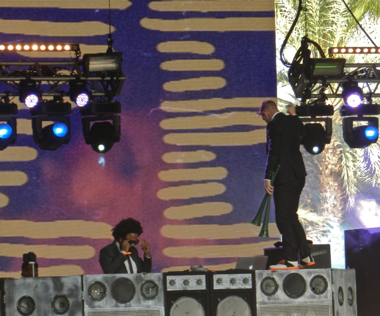 Major Lazer performing in the Mojave tent. Jillionaire on decks and Diplo on top of the speaker.