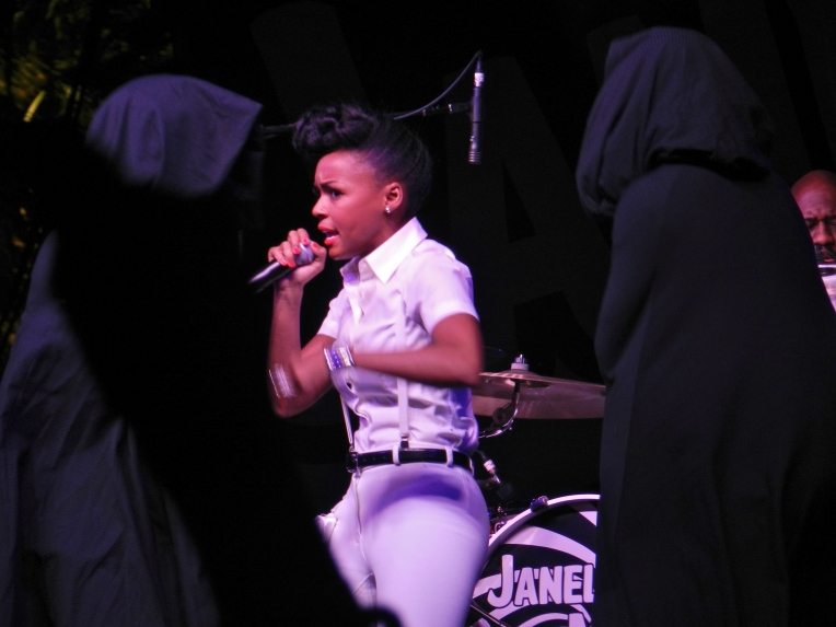 Janelle Monae and her cloaked dancers performing in the Gobi tent.