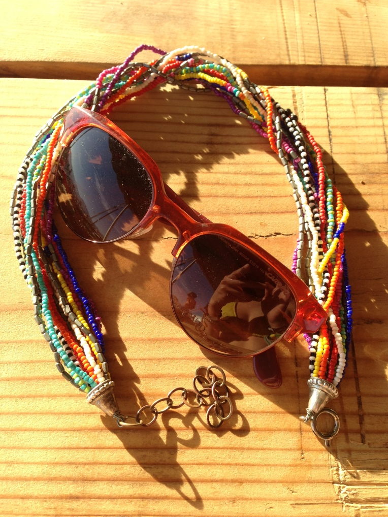 My accessories. Multi-strand seed bead necklace by One of a Kind Masterpiece, and Carrera sunglasses.