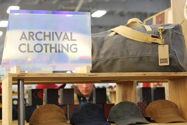 Canvas duffel and hats displayed at Archival Clothing
