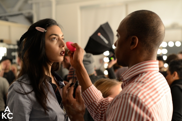 AJ cleaning up a models eyes, NY Fashion Week