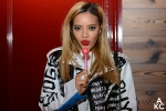 Angela Simmons posing with a lollipop from Sugar Factory.