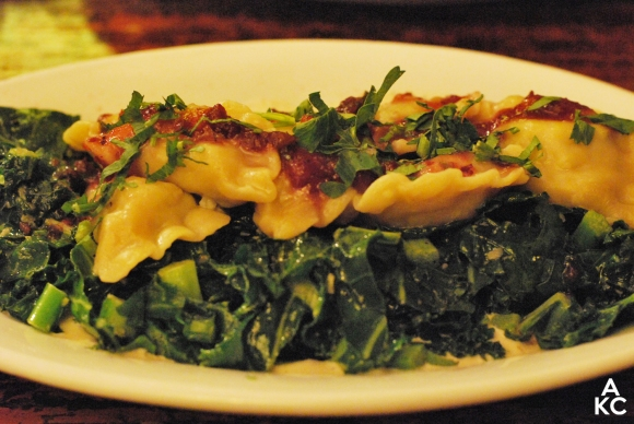 My meal: Pumpkin, butternut squash, and cranberry filled dumpling over sautéed kale.