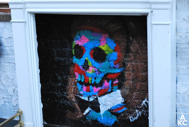 A custom piece by Bradley Theodore below the mantle.