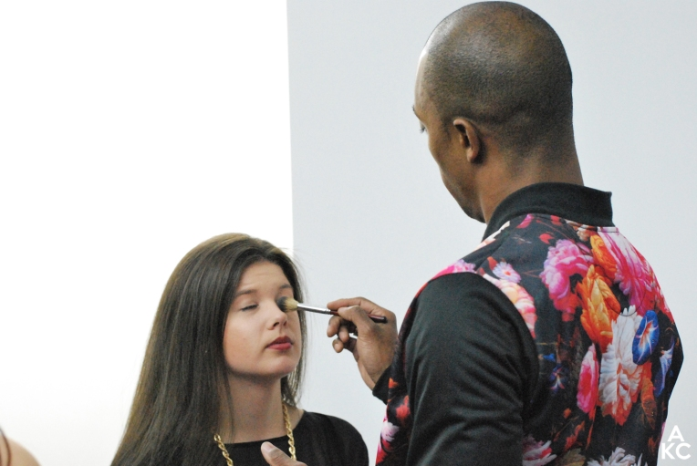AJ applying make-up to a guest